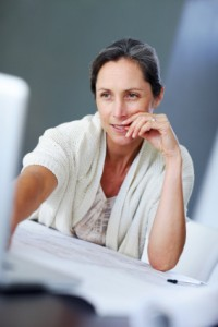 Middle aged woman at computer